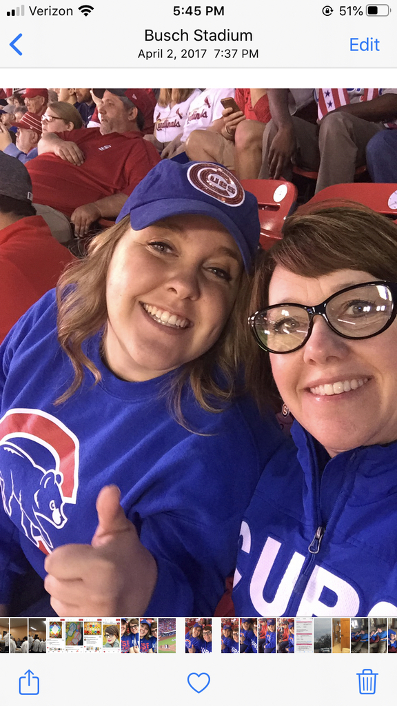 Abby and I are dressed alike in Cub's attire.